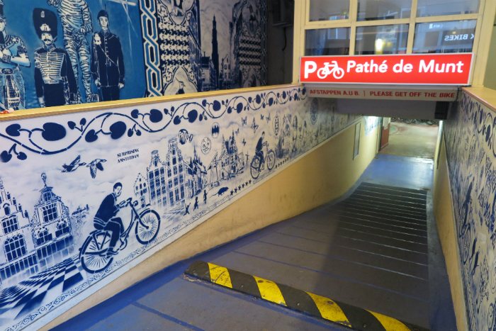 Murals by Stencil King Hugo Kaagman for an Amsterdam bicycle parking garage.